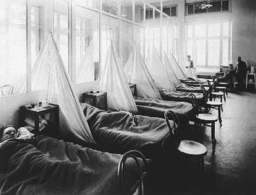 Influenza patients in a U.S. Army Camp Hospital in Aix-les-Baines, France, 1918. Soldiers returning home from World War I helped fuel the spread of influenza into one of the largest and deadliest pandemics in human history.